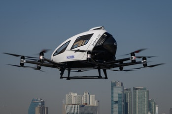 An EHang all-electric Vertical Takeoff and Landing (eVTOL) two-passenger multicopter aircraft, produced by China's Guangzhou EHang Intelligent Technology, performs an unmanned display flight at an event showcasing a 'Drone Traffic Management System' by the Ministry of Land Infrastructure and Transport, at Yeouido island in Seoul on November 11, 2020. (Photo by Ed JONES / AFP) (Photo by ED JONES/AFP via Getty Images)