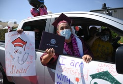 Mount San Antonio College graduating student Steven Anthony Gonzalez holds up his diploma from his car window after receiving it at the school's first drive-thru commencement ceremony, June 18, 2020 in Walnut, California. - The college design the car-based ceremony to comply with Los Angeles County and California state COVID-19 gathering restrictions. (Photo by Robyn Beck / AFP) (Photo by ROBYN BECK/AFP via Getty Images)