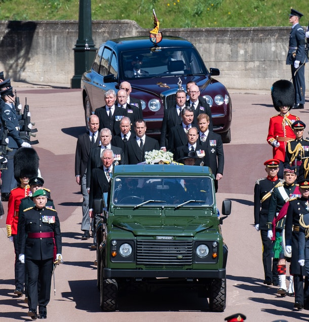 WINDSOR, ENGLAND - APRIL 17:  Prince Charles, Prince of Wales, Prince Andrew, Duke of York, Prince Edward, Earl of Wessex, Prince William, Duke of Cambridge, Peter Phillips, Prince Harry, Duke of Sussex, Earl of Snowdon David Armstrong-Jones and Vice-Admiral Sir Timothy Laurence  as well as Queen Elizabeth II by car follow Prince Philip, Duke of Edinburgh's coffin during the Ceremonial Procession during the funeral of Prince Philip, Duke of Edinburgh on April 17, 2021 in Windsor, England.  Prince Philip of Greece and Denmark was born 10 June 1921, in Greece. He served in the British Royal Navy and fought in WWII. He married the then Princess Elizabeth on 20 November 1947 and was created Duke of Edinburgh, Earl of Merioneth, and Baron Greenwich by King VI. He served as Prince Consort to Queen Elizabeth II until his death on April 9 2021, months short of his 100th birthday. His funeral takes place today at Windsor Castle with only 30 guests invited due to Coronavirus pandemic restrictions. (Photo by Pool/Samir Hussein/WireImage)