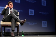 WASHINGTON, DC - MARCH 29: Fox News host Tucker Carlson discusses 'Populism and the Right' during th...