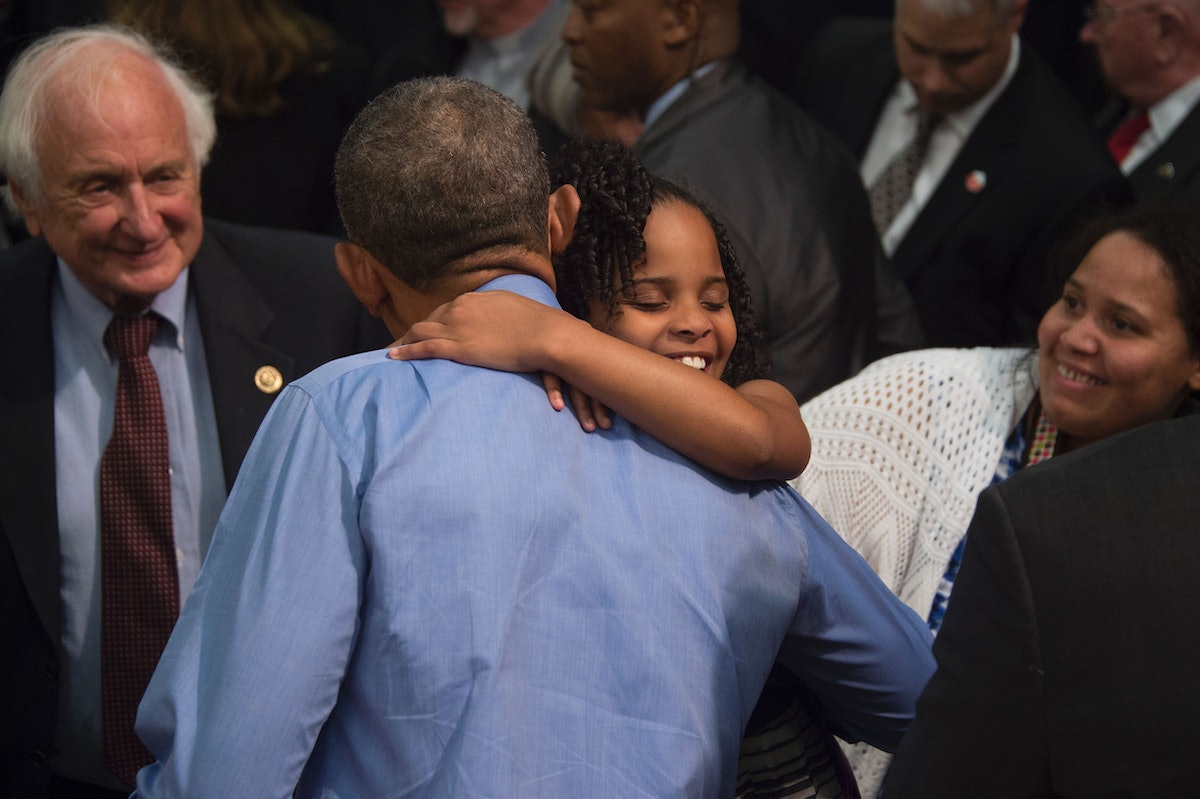 """""""Little Miss Flint"""" Mari Copeny, 8, hugs US President Barack Obama during an event at Northwestern High School in Flint, Michigan, May 4, 2016. Copeny wrote to the president before she traveling 12 hours by bus with more than 200 Flint residents to a congressional hearing on the city's water crisis. / AFP / Jim Watson        (Photo credit should read JIM WATSON/AFP via Getty Images)"""