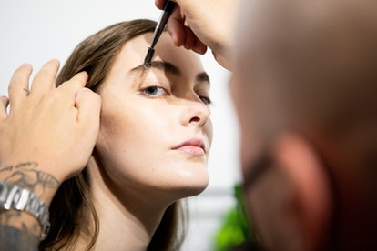MILAN, ITALY - SEPTEMBER 27: A make up artist does the final touch  of gel eyebrow during the line up before the show is seen backstage at the Shi.Rt fashion show during the Milan Women's Fashion Week on September 27, 2020 in Milan, Italy. (Photo by Rosdiana Ciaravolo/Getty Images)