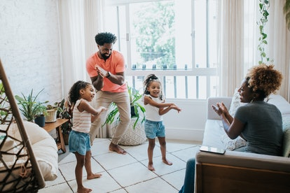 Happy family dancing at home