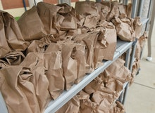 Muhlenberg twp., PA - September 10: A rack with bags containing grab and go breakfasts and lunches. ...