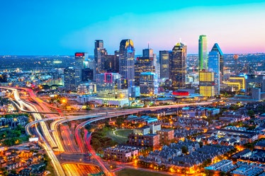 The Dallas skyline is a colorful landscape at dusk. Interstates 45 and 35 converge in a design fille...