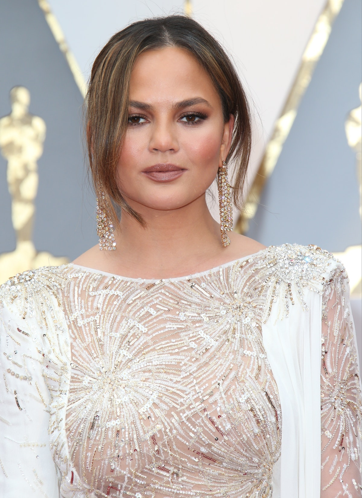 HOLLYWOOD, CA - FEBRUARY 26: Model Chrissy Teigen arrives at the 89th Annual Academy Awards at Holly...