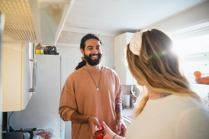 Couple cooking a vegan meal together in their kitchen in the North East of England.