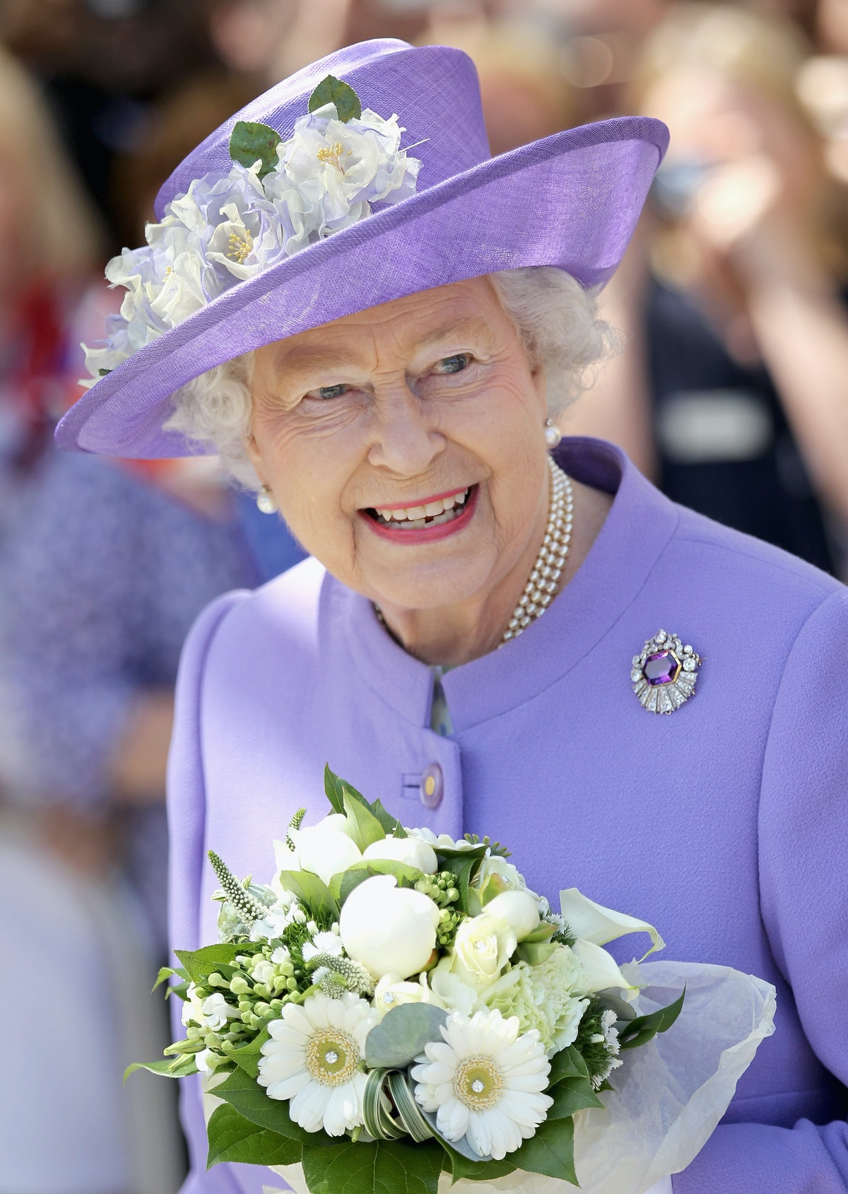 STEVENAGE, ENGLAND - JUNE 14:  Queen Elizabeth II arrives to open a new maternity ward at the Lister...