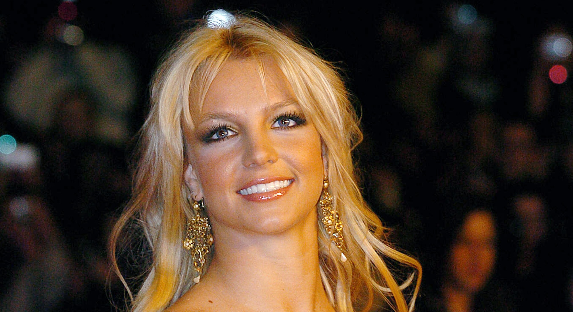 "US rock star Britney Spears arrives 24 January 2004 at Cannes' Palais des Festivals, for France's annual NRJ music awards. The awards are held as the International music industry descends on Cannes, southern France, for the annual MIDEM trade jamboree, the music world's premier trade show. The NRJ pop music station's awards are based on a public vote, with around 50 artists competing for 15 awards. NRJ is a popular commercial FM radio network whose name, when pronounced in French, makes the word ""energy"". AFP PHOTO PASCAL GUYOT (Photo by Pascal GUYOT / AFP) (Photo by PASCAL GUYOT/AFP via Getty Images)"