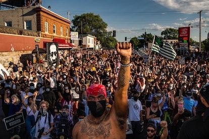 MINNEAPOLIS, MN - JUNE 5: Thousands of peaceful protestors arrive to George Floyd's memorial site on...