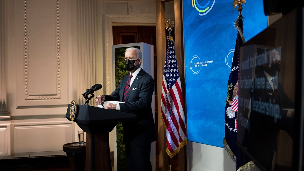 US President Joe Biden waits to speak during a climate change virtual summit from the East Room of t...