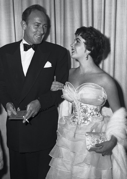 (Original Caption) 3/19/1953-Hollywood, California- Actress Elizabeth Taylor and her husband, Michael Wilding, attend the 25th annual Academy Awards presentation ceremonies in Hollywood.