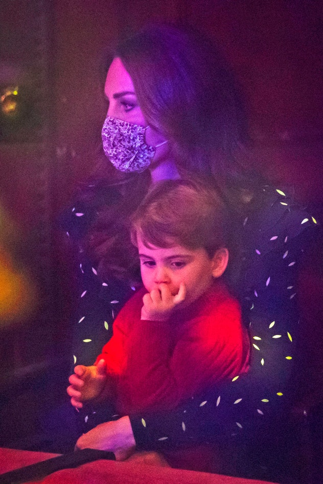 Prince Louis cuddles with his mom at Christmas.
