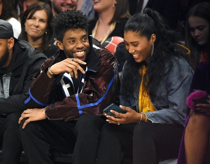 CHICAGO, ILLINOIS - FEBRUARY 16: Chadwick Boseman (L) and Taylor Simone Ledward attend the 69th NBA All-Star Game at United Center on February 16, 2020 in Chicago, Illinois. (Photo by Kevin Mazur/Getty Images)