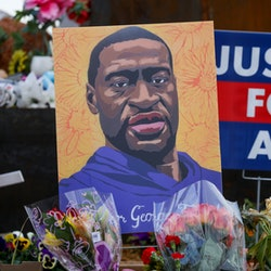 MINNEAPOLIS, MINNESOTA - APRIL 21: People lay flowers at a memorial in George Floyd Square in Minneapolis, Minnesota, United States on April 21, 2021. George Floyd by the Cup Foods where he was killed by Minneapolis Police Officer Derek Chauvin in Minneapolis, Minnesota. (Photo by Yasin Ozturk/Anadolu Agency via Getty Images)