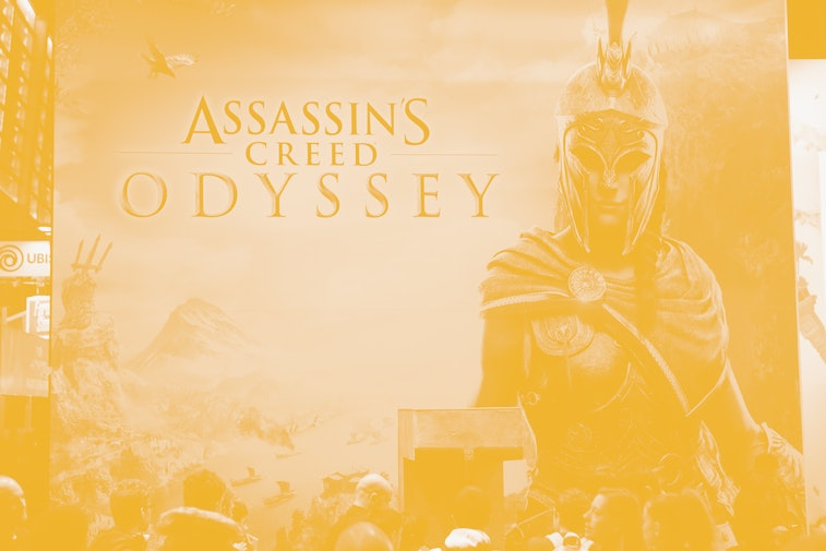 PARIS, FRANCE - OCTOBER 27:  Visitors queue to play the video game  'Assassin's Creed Odyssey' developed by Ubisoft Quebec and published by Ubisoft during the 'Paris Games Week' on October 27, 2018 in Paris, France. 'Paris Games Week' is an international trade fair for video games and runs from October 26 to 31, 2018.  (Photo by Chesnot/Getty Images)