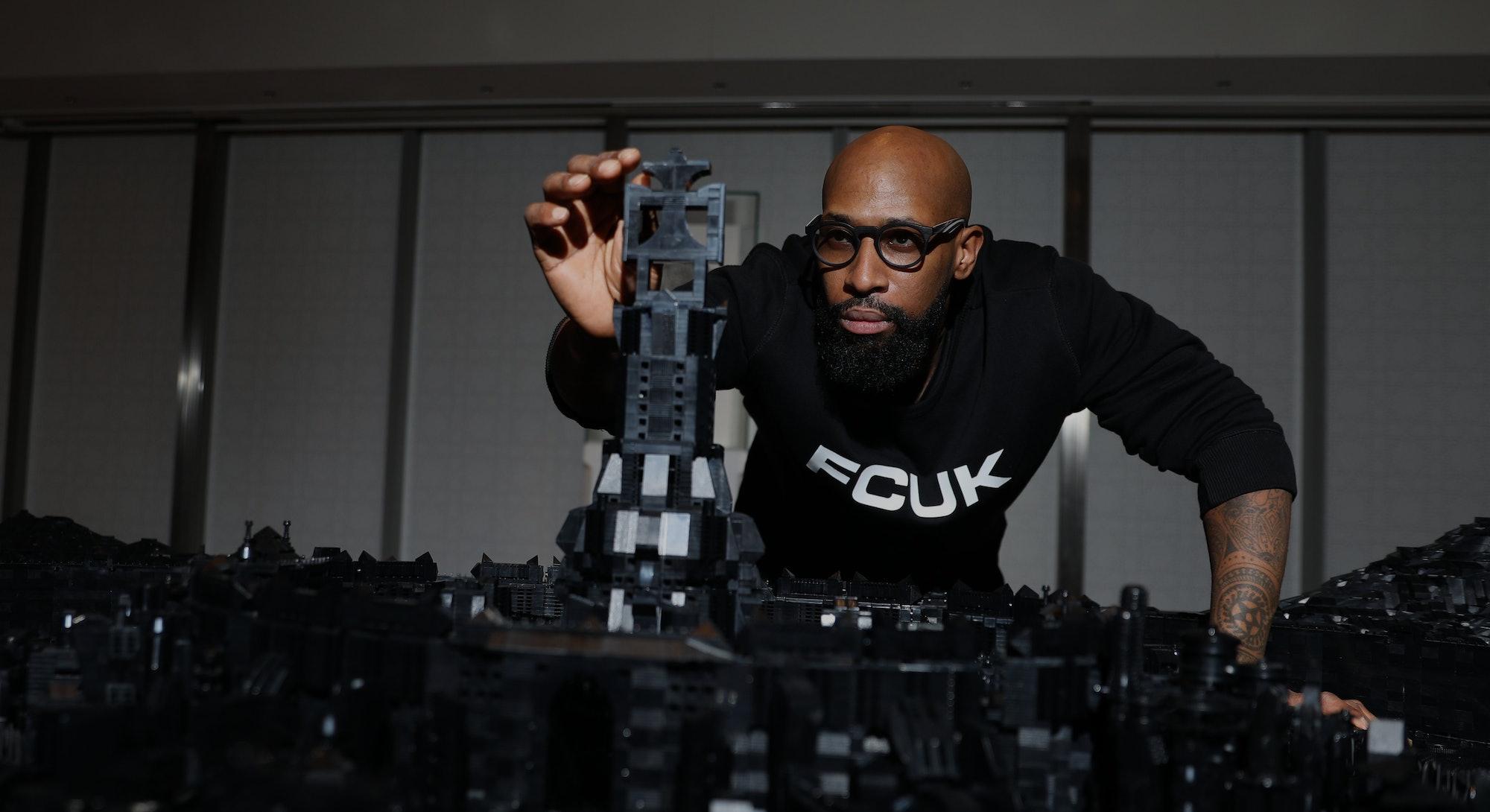 TORONTO, ON - NOVEMBER 19: Ghanaian-Canadian artist Ekow Nimako creates a Lego sculpture at the Aga Khan Museum. The work is titled Building Black: Civilizations.        (Rene Johnston/Toronto Star via Getty Images)