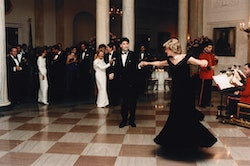 John Travolta twirls Princess Diana on the dance floor while at a White House banquet. Ronald and Nancy Reagan can be seen in the background. (Photo by © Pool Photograph/Corbis/Corbis via Getty Images)