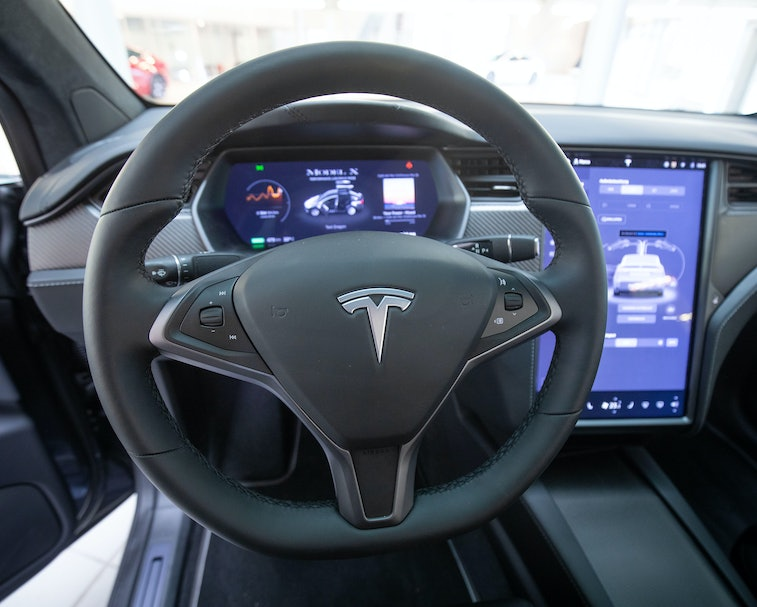 21 October 2020, Hamburg: View into the interior with steering wheel and display of a Tesla Model X in the new Tesla Service Center. Photo: Christian Charisius/dpa (Photo by Christian Charisius/picture alliance via Getty Images)