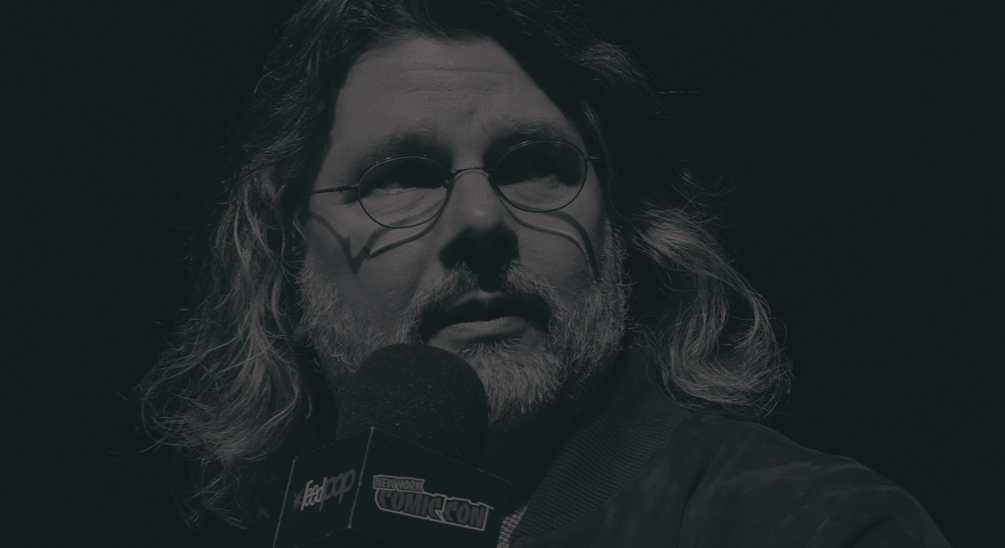 """NEW YORK, NEW YORK - OCTOBER 05: Ronald D. Moore speaks on stage at the """"For All Mankind"""": Exclusive Sneak Peek and Panel during New York Comic Con 2019 Day 3 at Hammerstein Ballroom on October 05, 2019 in New York City. (Photo by Eugene Gologursky/Getty Images for ReedPOP )"""