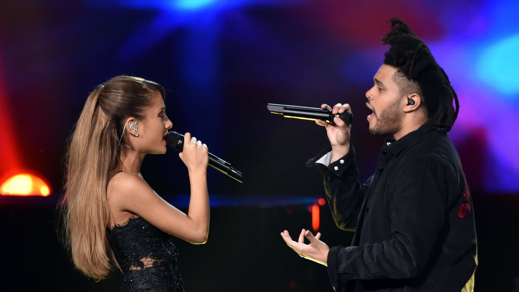 LOS ANGELES, CA - NOVEMBER 23:  Recording artists Ariana Grande (L) and The Weeknd  perform onstage at the 2014 American Music Awards at Nokia Theatre L.A. Live on November 23, 2014 in Los Angeles, California.  (Photo by Kevin Winter/Getty Images)