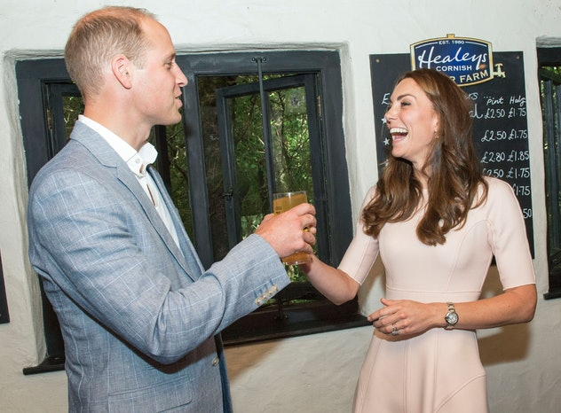 Britain's Catherine, Duchess of Cambridge (R) laughs as she offers Britain's Prince William, Duke of Cambridge a pint of cider she poured during a visit to Healey's Cornish Cider Farm near Truro on September 1, 2016.    / AFP / POOL AND AFP / Arthur Edwards        (Photo credit should read ARTHUR EDWARDS/AFP via Getty Images)