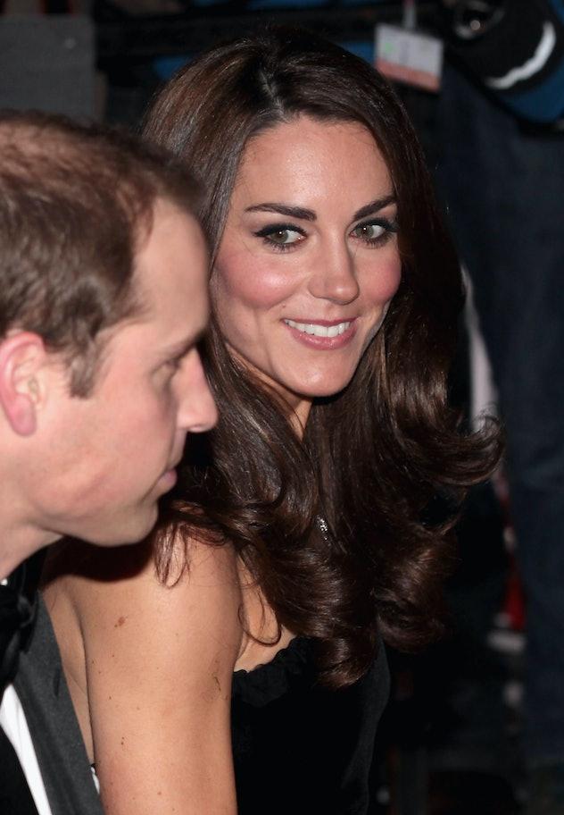LONDON, ENGLAND - DECEMBER 19:  Catherine, Duchess of Cambridge looks towards Prince William, Duke o...