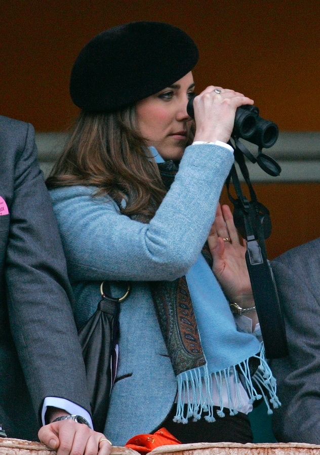 CHELTENHAM, UNITED KINGDOM - MARCH 16:  Kate Middleton uses binoculars to watch the Gold Cup horse r...