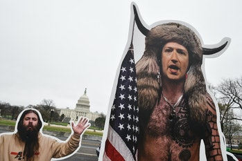 An effigy of Facebook CEO, Mark Zuckerberg (R), dressed as a January 6, 2021, insurrectionist is placed near the US Capitol in Washington, DC, on March 25, 2021. - Protester set up effigies of Big Tech CEO's as the US Congress holds hearings March 25 about the spread of disinformation and misinformation on their platforms. (Photo by MANDEL NGAN / AFP) (Photo by MANDEL NGAN/AFP via Getty Images)