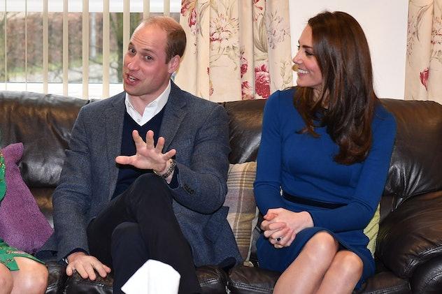 Britain's Prince William, Duke of Cambridge (L) and Britain's Catherine, Duchess of Cambridge speak ...