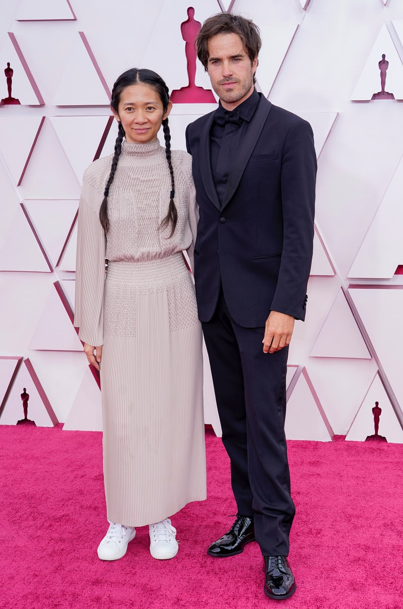 Chloe Zhao and Joshua James Richards attend the 93rd Annual Academy Awards at Union Station on April 25, 2021 in Los Angeles, California. (Photo by Chris Pizzelo-Pool/Getty Images)