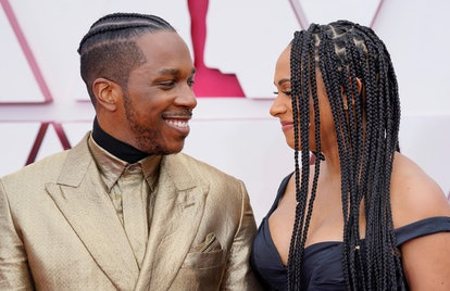 LOS ANGELES, CALIFORNIA – APRIL 25: (L-R) Leslie Odom Jr. and Nicolette Robinson attend the 93rd Annual Academy Awards at Union Station on April 25, 2021 in Los Angeles, California. (Photo by Chris Pizzelo-Pool/Getty Images)
