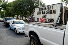 """Reading, PA - September 25: A sign on the back of a truck in the caravan that reads """"Do your part, s..."""