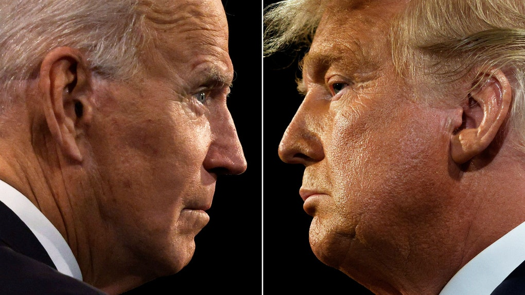 (COMBO) This combination of pictures created on October 22, 2020 shows US President Donald Trump (R) and Democratic Presidential candidate and former US Vice President Joe Biden during the final presidential debate at Belmont University in Nashville, Tennessee, on October 22, 2020. (Photos by JIM BOURG / AFP) (Photo by JIM BOURG/AFP via Getty Images)