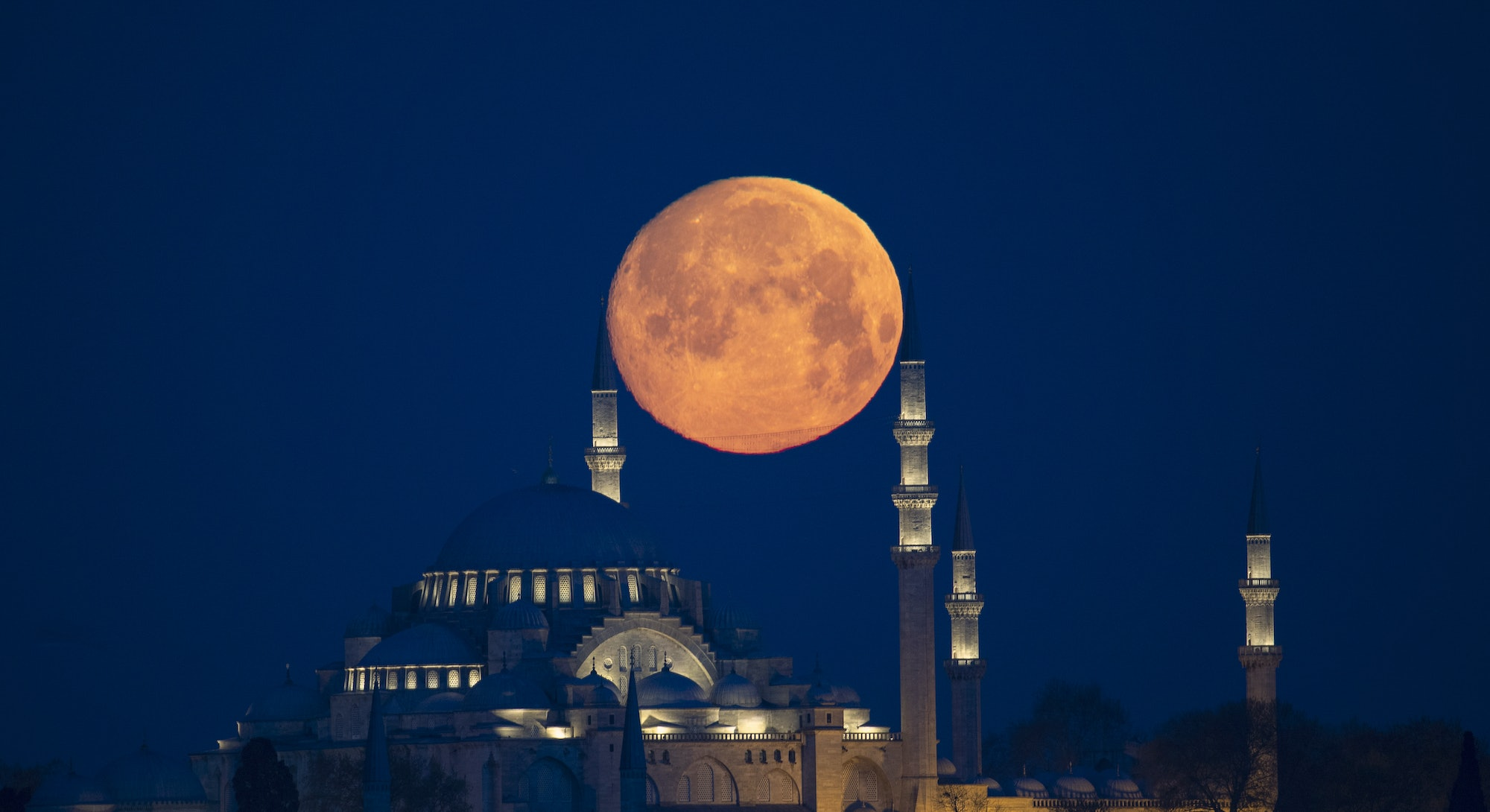 ISTANBUL, TURKEY - APRIL 26: Full moon rises over the Suleymaniye Mosque during the holy Islamic fasting month of Ramadan in Istanbul, Turkey on April 26, 2021. (Photo by Isa Terli/Anadolu Agency via Getty Images)