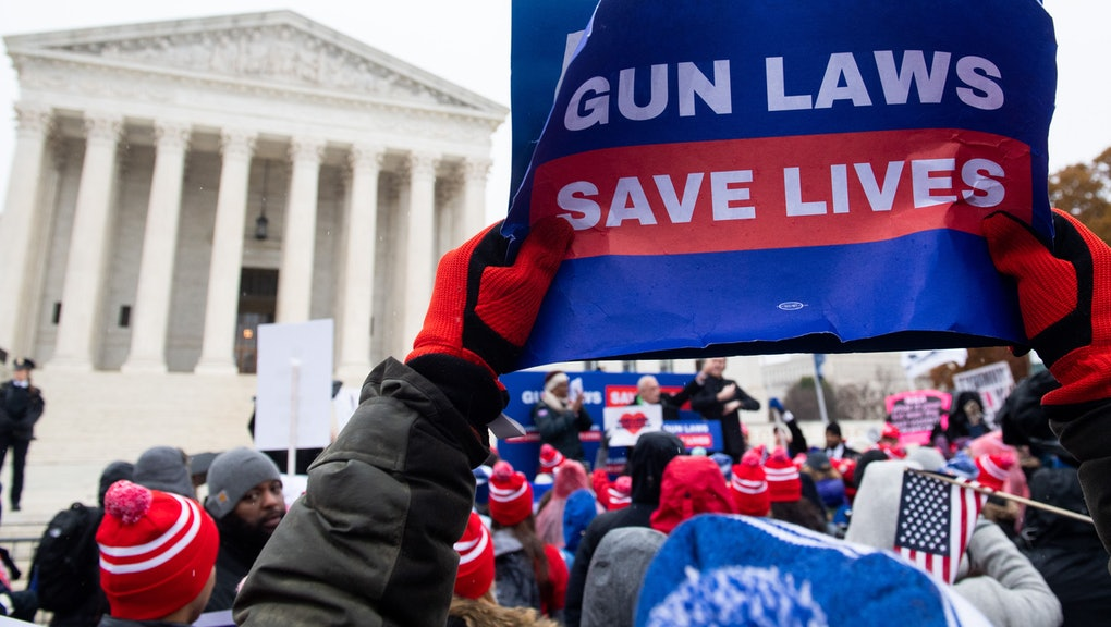 Supporters of gun control and firearm safety measures hold a protest rally outside the US Supreme Court as the Court hears oral arguments in State Rifle and Pistol v. City of New York, NY, in Washington, DC, December 2, 2019. - The case marks the first time in nearly 10 years that the Supreme Court has heard a Second Amendment gun ownership case. (Photo by SAUL LOEB / AFP) (Photo by SAUL LOEB/AFP via Getty Images)