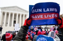 Supporters of gun control and firearm safety measures hold a protest rally outside the US Supreme Co...
