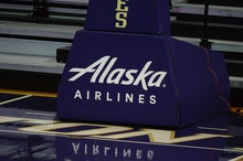 SEATTLE, WA - JANUARY 24: An Alaska Airlines ad is seen during a PAC12 conference college basketball...