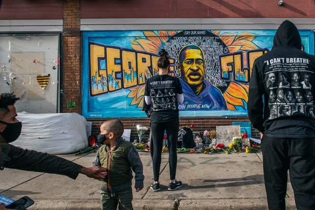 MINNEAPOLIS, MN - APRIL 20: People pay their respects at the mural of George Floyd at the intersecti...