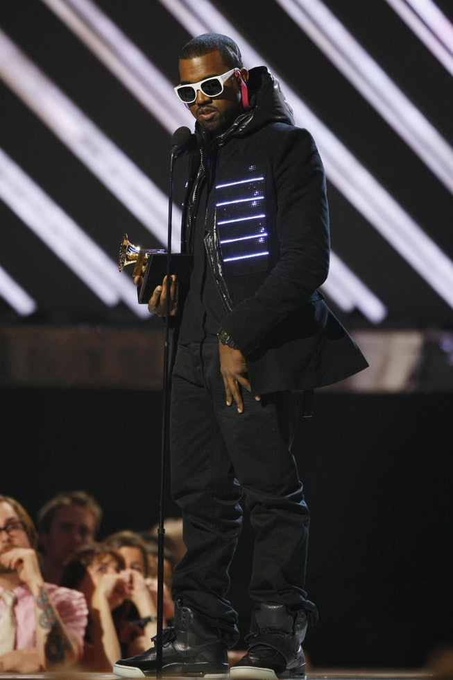 The 2008 winner for Best Rap Album Kanye West  accepts the trophy at the 50th Grammy Awards in Los Angeles on February 10, 2008. AFP PHOTO/Robyn BECK (Photo credit should read ROBYN BECK/AFP via Getty Images)