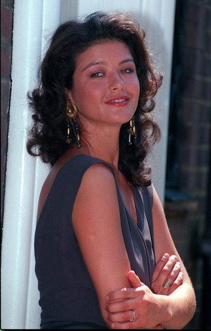 CATHERINE ZETA JONES 1991: Welsh actress Catherine Zeta Jones at the launch of 'Out of the Blue', a new comedy drama written by Graham Alborough, in which she stars as the innocent young girl, Chirsty, seduced by film maker Alan (Colin Firth).   (Photo by PA Images via Getty Images)