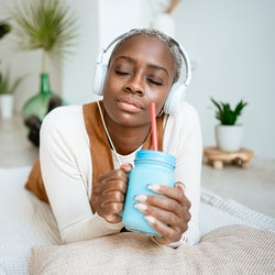 A woman listens to a Twitter Space audio conversation