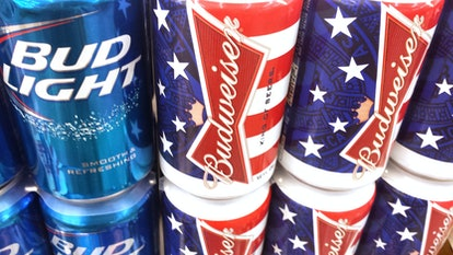 Los Angeles, California, USA - July 1, 2013: Budweiser, the quintessential American beer, issues beer cans commemorating July 4th. The beer stays cool on market shelf while on display.