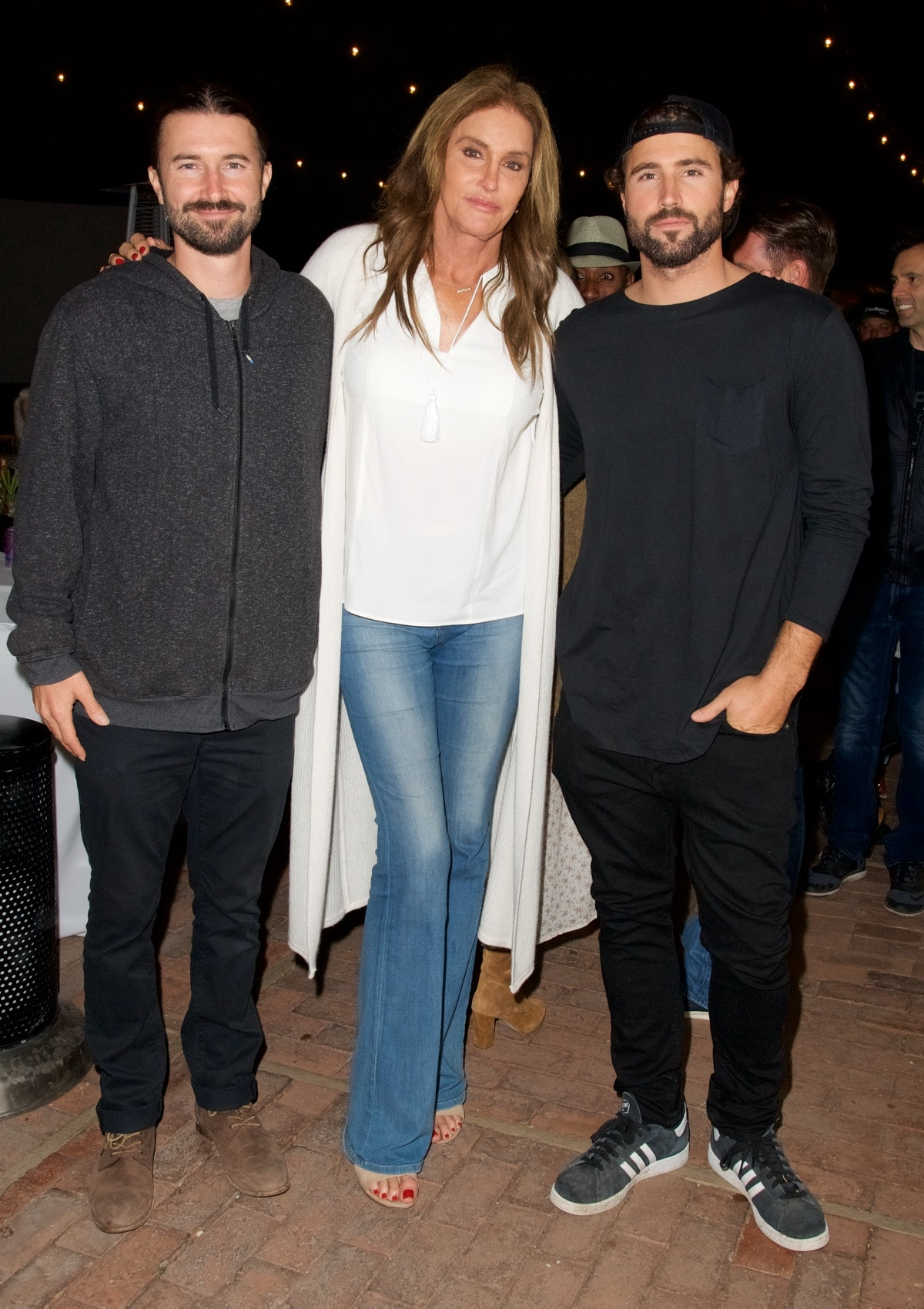 """MALIBU, CA - NOVEMBER 19:  (L-R) Brandon Jenner, Caitlyn Jenner and Brody Jenner attend the Brandon Jenner Record Release Party For """"Burning Ground"""" on November 19, 2016 in Malibu, California.  (Photo by Earl Gibson III/Getty Images)"""