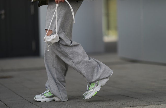 DUSSELDORF, GERMANY - FEBRUARY 27: Maria Barteczko wearing grey Bershka jogging pants, white green New Balance sneakers, white Mango mini pouch on February 27, 2021 in Dusseldorf, Germany. (Photo by Jeremy Moeller/Getty Images)