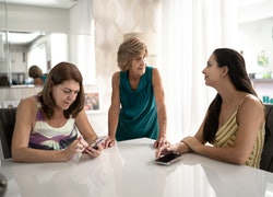Three generation family talking at home
