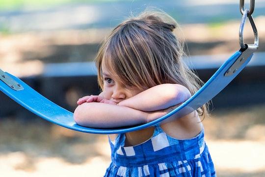 Sad caucasian autistic little girl
