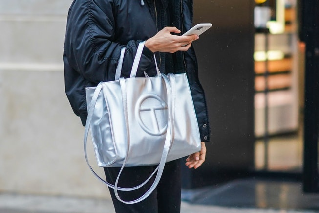 PARIS, FRANCE - DECEMBER 12: A passerby wears a black bomber jacket and a silver Telfar logo large bag, on December 12, 2020 in Paris, France. (Photo by Edward Berthelot/Getty Images)
