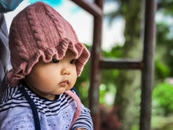baby wearing a pink knit beanie