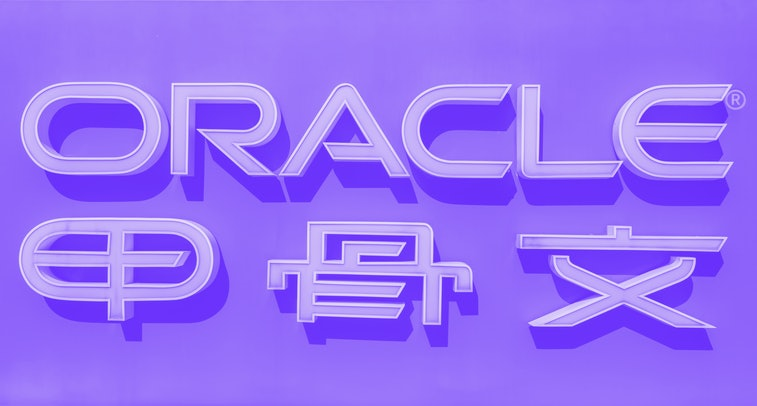 """Oracle company signage is seen in front of the US-based technology company's office building in Beijing on September 16, 2020. - Silicon Valley tech giant Oracle is """"very close"""" to sealing a deal to become the US partner to Chinese-owned video app TikTok to avert a ban in the United States, President Donald Trump said. (Photo by NICOLAS ASFOURI / AFP) (Photo by NICOLAS ASFOURI/AFP via Getty Images)"""